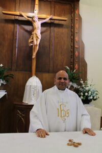 A Picture of Fr. Nusi in fromt of the Altar